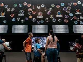 Family discussing the Marvel Cinematic Universe project at GOMA