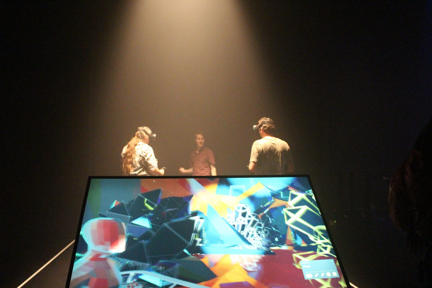 Colliding Dimensions in use by 2 men with a screen in front displaying what is happening in virtual reality