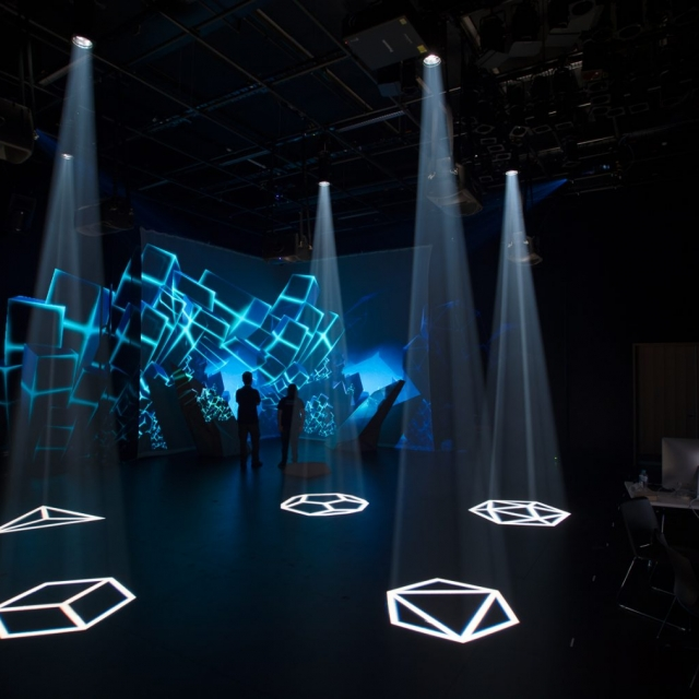 Colliding Dimensions finalised set-up with darkened room, blue shards and shaped lights projected on the floor