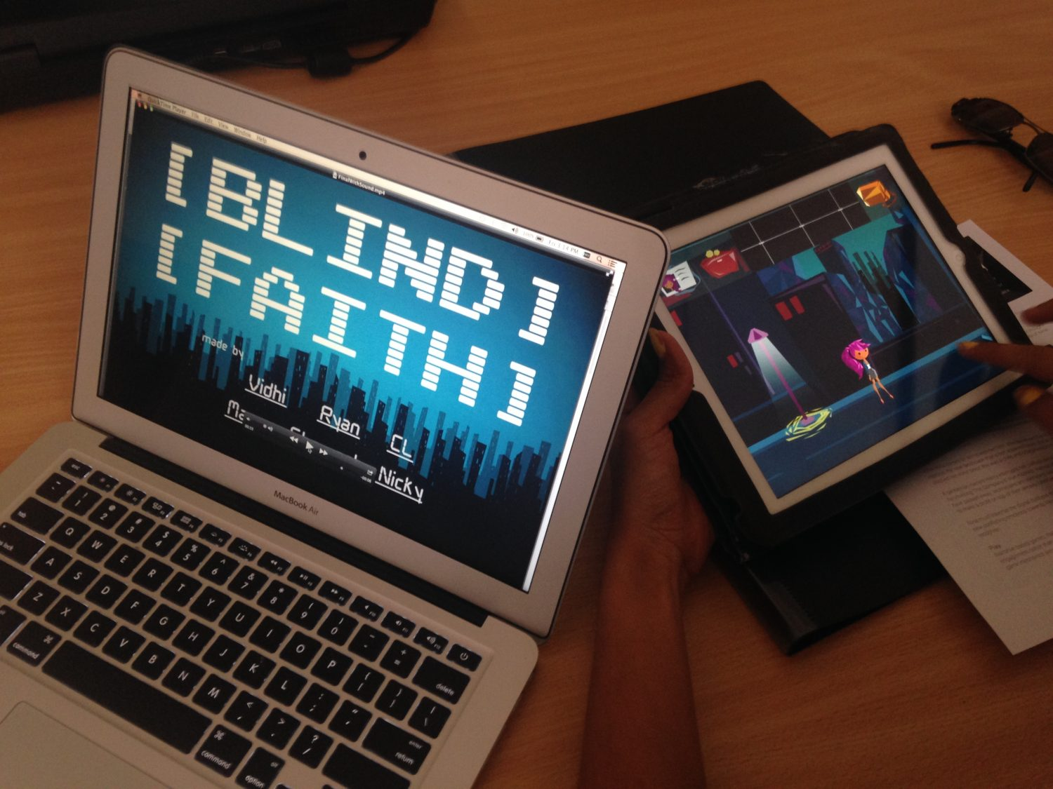 Blind Faith video on laptop and Blind Faith game on iPad