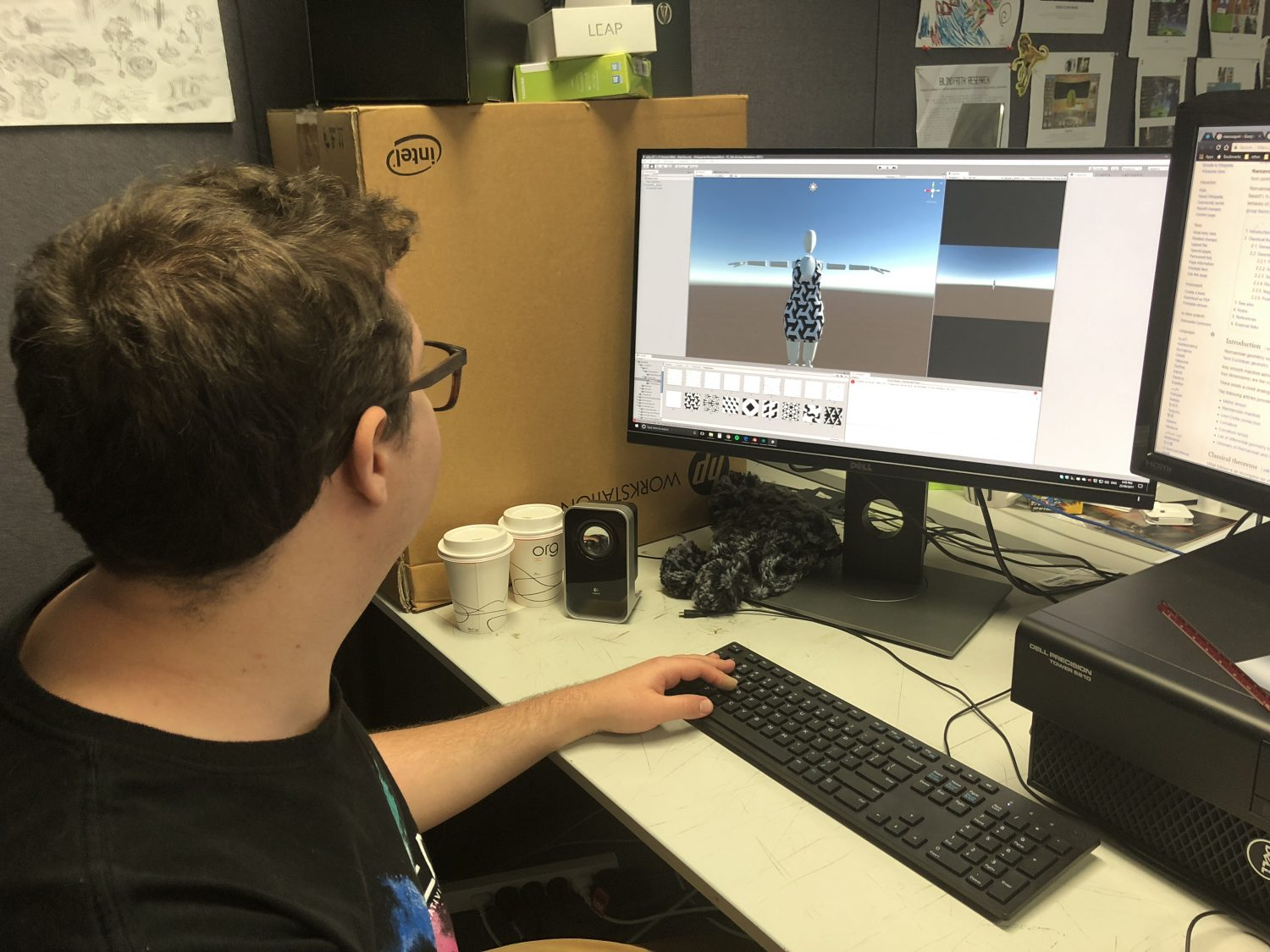 Wade preparing a mannequin design in unity at his desktop computer