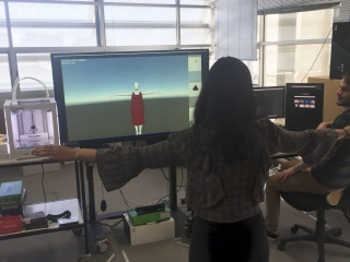 Aurelia trying the controls of the Virtual Fashion Studio with the Kinect