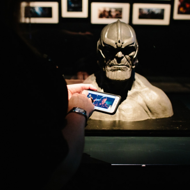Deb interacting with the Thanos statue with the Marvel Mobile app at GOMA 2017