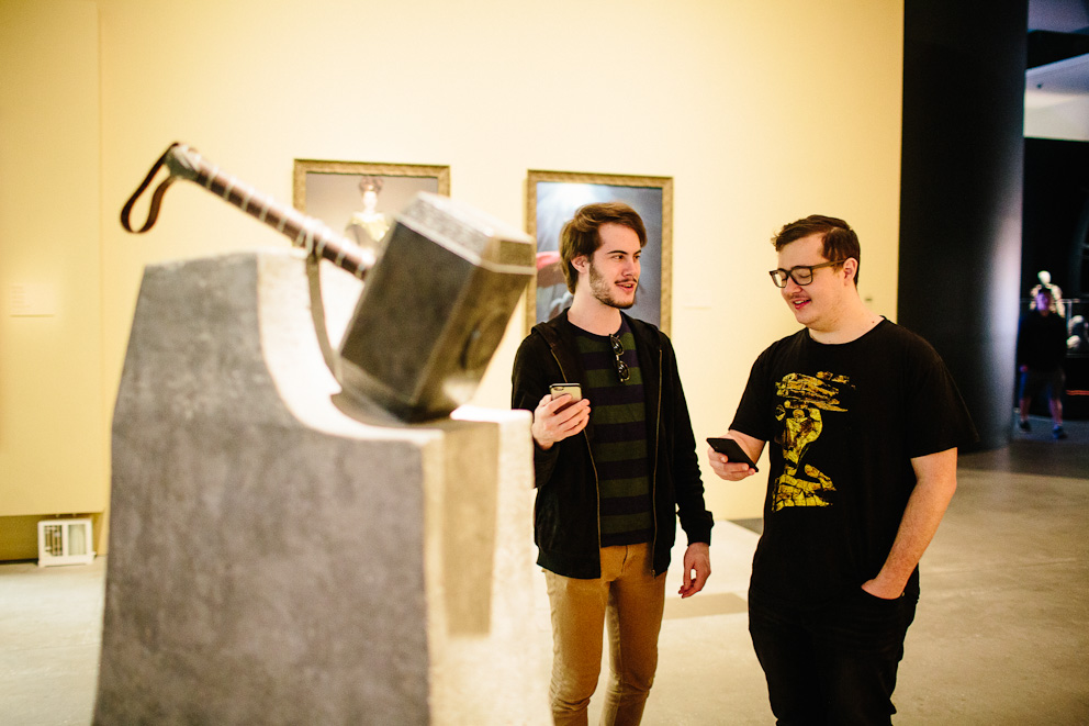 Ryan and Wade next to a statue of Thor's hammer learning about its lore with the Marvel Mobile app at GOMA 2017